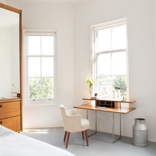 Mid-sized scandinavian bedroom in London with white walls.