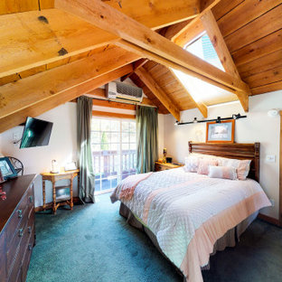 This is an example of a mid-sized country loft-style bedroom in New York with carpet and turquoise floor.