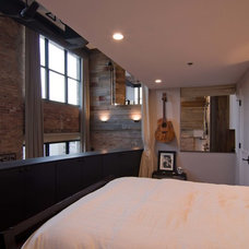 Industrial Bedroom by Besch Design, Ltd.