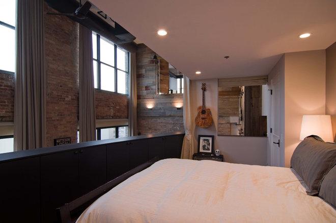 Industrial Bedroom by Besch Design, Ltd.