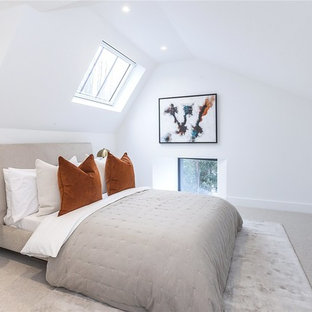 Medium sized classic master bedroom in London with white walls, carpet and grey floors.