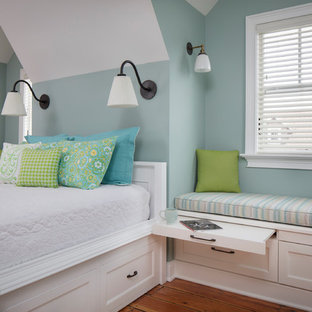 Design ideas for a large beach style loft-style bedroom in Other with blue walls, medium hardwood floors, brown floor and no fireplace.