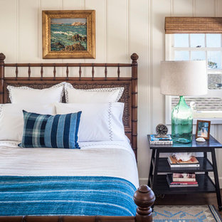 Inspiration for a small coastal dark wood floor bedroom remodel in Orange County with white walls