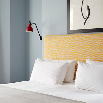 Trendy bedroom photo in London with blue walls