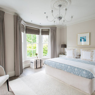 Photo of a large classic master bedroom in London.