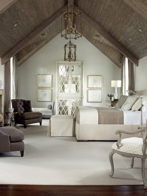 Example Of A Large Classic Master Dark Wood Floor And Brown Bedroom Design In Houston