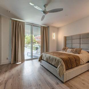 Trendy guest plywood floor and beige floor bedroom photo in San Francisco
