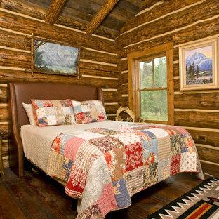 Example of a mountain style dark wood floor bedroom design in Denver