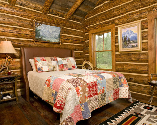 Example Of A Mountain Style Dark Wood Floor Bedroom Design In Denver