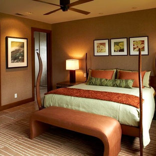 Esempio di una camera da letto tropicale