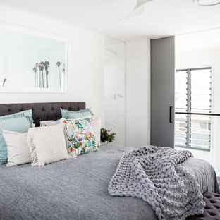 Contemporary bedroom in Sunshine Coast with white walls, carpet and grey floor.