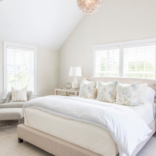 Inspiration for a mid-sized beach style bedroom remodel in Boston with beige walls