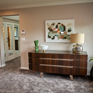 Mid-sized transitional limestone floor and beige floor bedroom photo in San Diego with beige walls