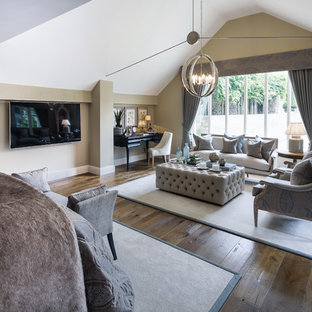 Inspiration for an expansive farmhouse master bedroom in Oxfordshire with beige walls and dark hardwood flooring.