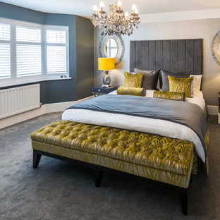 This is an example of a medium sized contemporary bedroom in Kent with grey walls, carpet and grey floors.