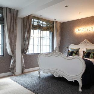 Bedroom - mid-sized industrial master light wood floor bedroom idea in London with gray walls