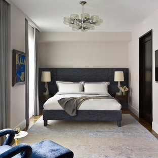Inspiration For A Transitional Medium Tone Wood Floor And Brown Floor  Bedroom Remodel In New York