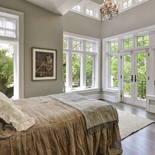 Example of a large transitional guest medium tone wood floor bedroom design in Charleston with beige walls