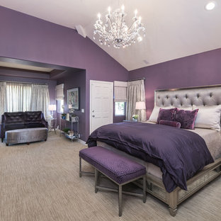 Inspiration for a large transitional master bedroom in Los Angeles with purple walls, no fireplace, carpet and brown floor.