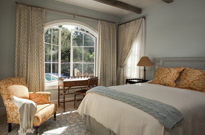 Mediterranean Bedroom by Nautilus Architects LLC