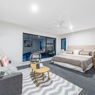 Inspiration for a mid-sized beach style master bedroom in Canberra - Queanbeyan with white walls, carpet and grey floor.