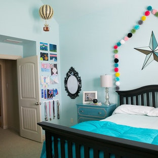 Example of a mid-sized eclectic carpeted bedroom design in Dallas with blue walls