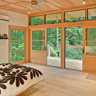 Trendy light wood floor bedroom photo in Seattle with beige walls