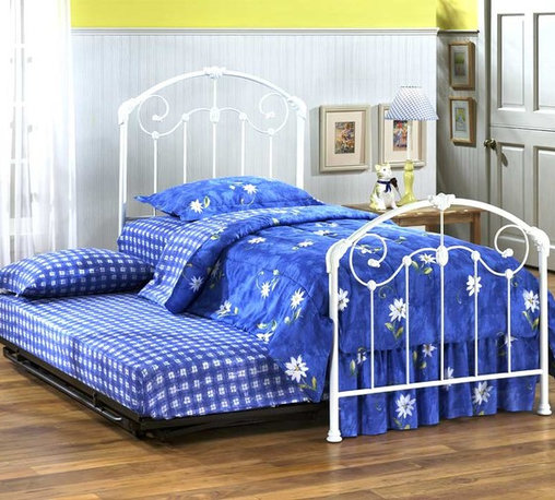 Hillsdale Furniture - Maddie Twin Panel Bed w Roll-Out Trundle in G - Fun, yet functional, this steel framed bed has curves that make it perfect for a little girl's room! Graduate from a toddler bed to this attractive bed, and include the optional trundle to allow your daughter to invite a friend over to stay the night! Attractive and sturdy, this bed will invite your daughter to enjoy a good night's sleep! With simple decorative curves and accents The Maddie Twin Size Bed in Glossy White Finish has a Victorian Style, and comes with an optional trundle. Your daughter can have her friends spend the night with this glossy metal bed and optional trundle. * Includes headboard and footboard, suspension deck and roll-out trundle. Mattress not included. Sturdy metal frame. Victorian style. Headboard: 39 in. L x 54 in. H. Footboard: 39 in. L x 35.5 in. HWith simple decorative curves and accents The Maddie Twin size bed in Glossy White finish has a Victorian Style, and comes with a roll-out trundle. The sturdy metal frame provides a secure support while the curved headboard and footboard give it a softer feel. A lightly scaled, victorian styled bed that marries interesting scroll work with vivid castings. Perfect for the little girls first bed.