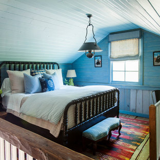 Country loft-style bedroom in Atlanta with blue walls.