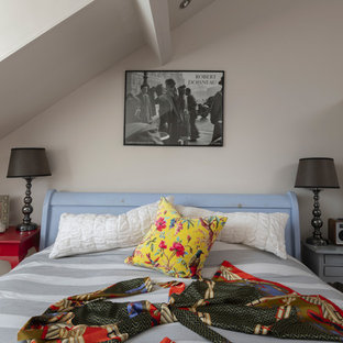 Inspiration for an eclectic bedroom in Other with beige walls.