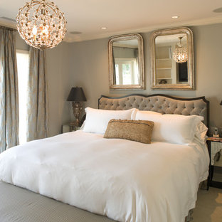 This is an example of a traditional bedroom in Seattle with grey walls.
