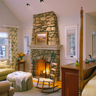 Large arts and crafts master dark wood floor bedroom photo in Boston with white walls, a standard fireplace and a stone fireplace