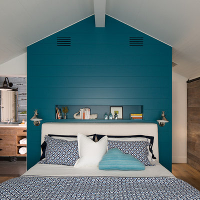 Mid-sized beach style master medium tone wood floor bedroom photo in San Diego with white walls and no fireplace