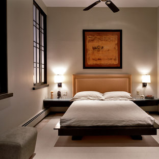 Inspiration for a contemporary bedroom remodel in Bridgeport with beige walls