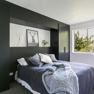 Design ideas for a scandinavian bedroom in Sydney with black walls, carpet and grey floor.