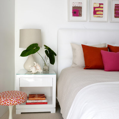 Beach style carpeted bedroom photo in Los Angeles with white walls