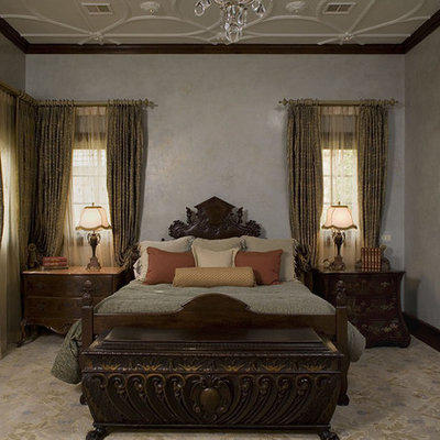 Inspiration for a timeless bedroom remodel in Austin with beige walls