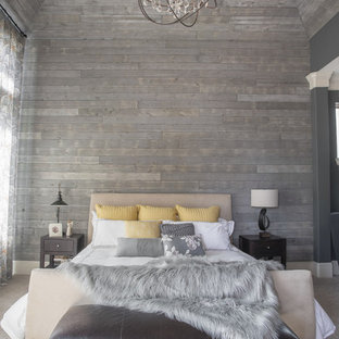 This is an example of a large contemporary master bedroom in Houston with grey walls, carpet and no fireplace.
