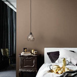 Example of a mid-sized trendy carpeted bedroom design in Melbourne with brown walls