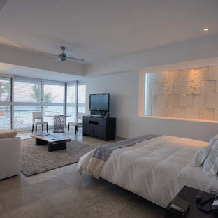 Design ideas for a large contemporary master bedroom in Miami with white walls, limestone floors and no fireplace.