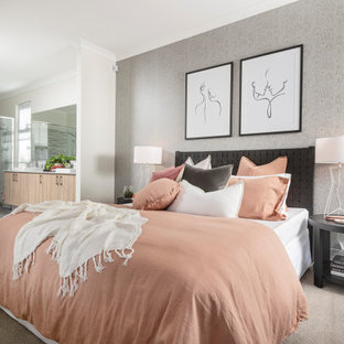 Photo of a contemporary master bedroom in Perth with white walls, carpet, no fireplace and beige floor.