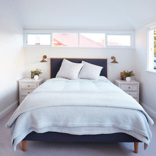 Inspiration for a mid-sized transitional master bedroom in Sydney with white walls, carpet, no fireplace and grey floor.