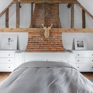 Design ideas for a large rural master bedroom in Oxfordshire with white walls and no fireplace.