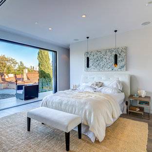 Example of a trendy dark wood floor bedroom design in Los Angeles with white walls