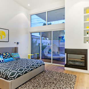Bedroom - contemporary bedroom idea in Los Angeles with a corner fireplace