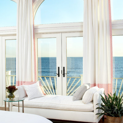 Inspiration for a large coastal master medium tone wood floor bedroom remodel in Boston with pink walls