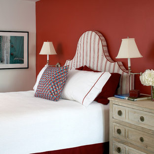 Mid-sized coastal guest medium tone wood floor bedroom photo in Boston with red walls