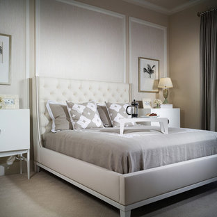 Inspiration for a large modern master carpeted bedroom remodel in Miami with beige walls