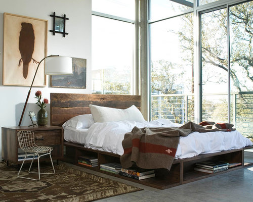 Best Industrial Bedroom Design Ideas   Remodel Pictures   Houzz Example of an urban bedroom design in Los Angeles with white walls   concrete floors and. Industrial Bedroom Ideas. Home Design Ideas