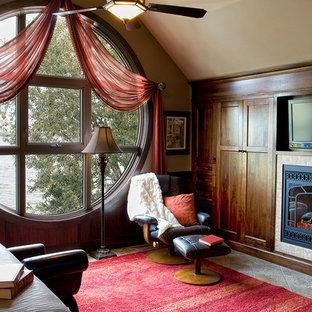 Mittelgroßes Klassisches Hauptschlafzimmer mit Travertin, Kamin und Kaminumrandung aus Stein in Calgary